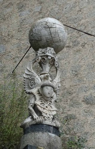 arpy supporting a globe rochetta mattei