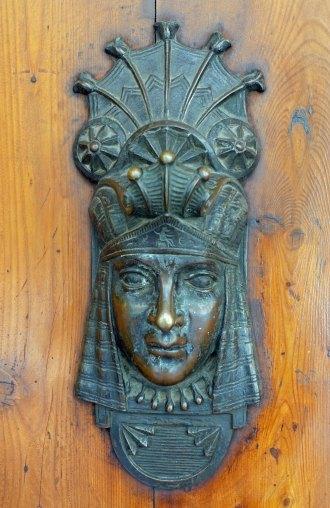 Egyptian influenced doorknocker.